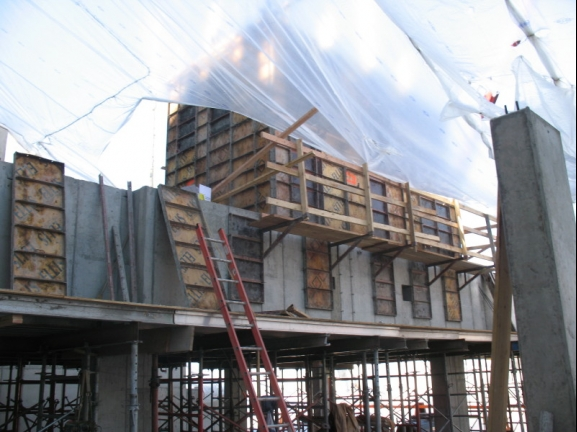 Elevator core forms on concrete beams at parking level